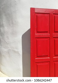 The red door on the white wall background, Wood door is a good material to decorate the loft home style.