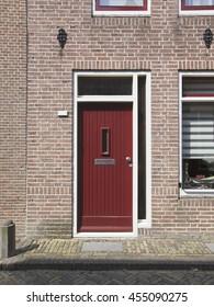 Red door part of a home, Netherlands, Europe