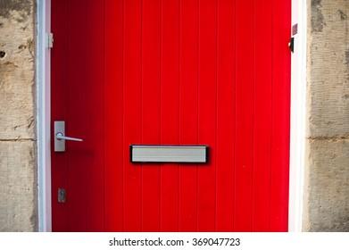 Red door in a stone building