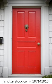 A red door in a white wall at eye-level