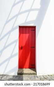Red door of windmill, Sao Miguel, Azores, Portugal, Europe