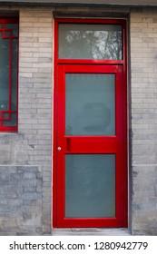 Red doors and characteristics of brick wall restoring ancient ways.