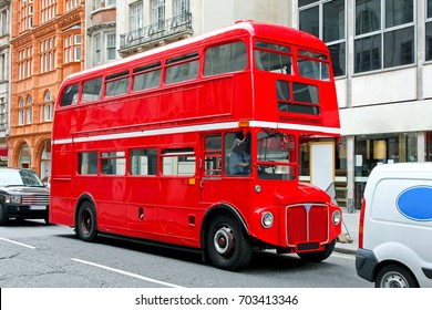 Red double deck bus at heritage route