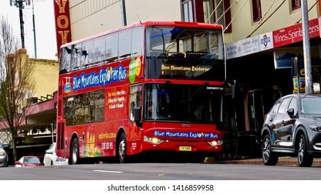 Red Double Decker Tourist Bus on Katoomba St, Katoomba, New South Wales, Australia on 5 June 2019.