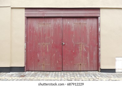 A red double doorway in Plymouth in Devon