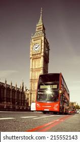 Red doubledecker bus in front of Big Ben in London, toned image
