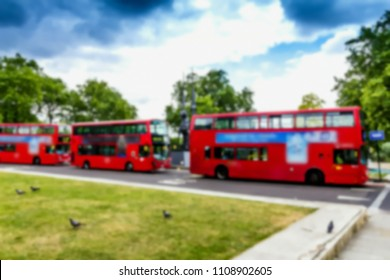 Red double-decker tourist buses await tourists . London. Blurred view