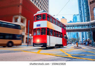 Red double-decker tram in the central district of Hong Kong.