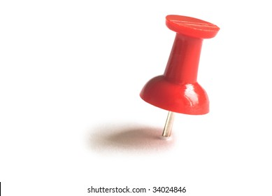 Red drawing pin with shadow. isolated on white background with clipping path.