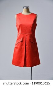 red dress clothing on mannequin-gray background