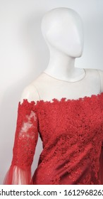Red Dress with Laces and Floral Embroidery on a White Mannequin, shot in a Studio with White Background.