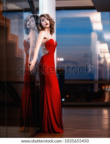Red Dress Model Standing By Window Stock Photo (Edit Now) 1035655450 ... 7ff977f7f