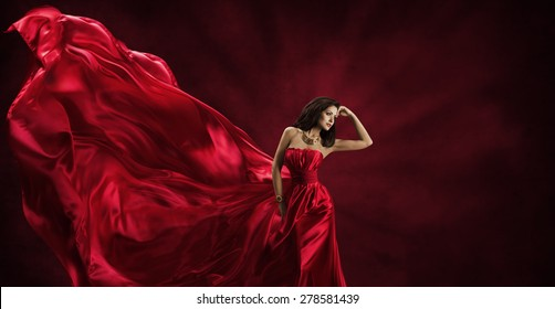 Red Dress, Woman in Flying Fashion Silk Fabric Clothes, Model Posing with Blowing Waving Cloth, Beauty Concept