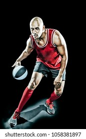 Red dressed basketball player in action over black background