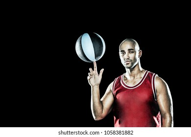 Red dressed basketball player spinning a basketball on his finger