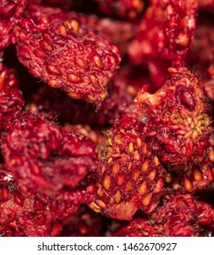 Red dried strawberries as background .