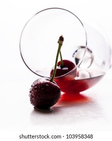 Red drink and ripe cherry berries