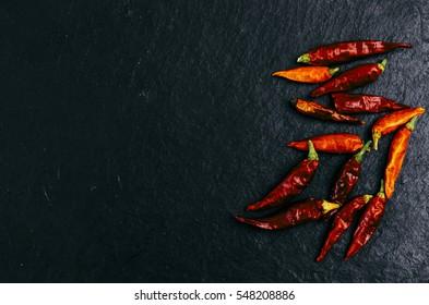 Red dry pepper on the dark black background