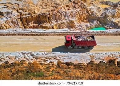 The red dump truck. Kaolin quarry. Vetovo village area, Bulgaria.