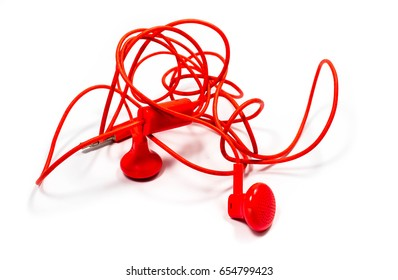 Red earphone on white background.Soft focus.