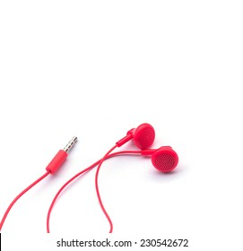 red earphones on white background isolated with path