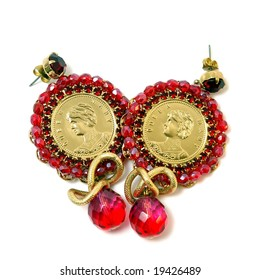 The Red earrings with queen on white background.
