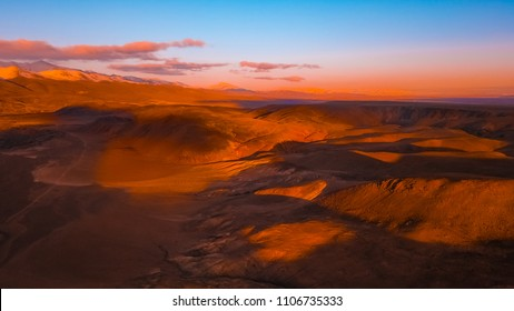 Red earth with iron oxides at sunset aerial view. Beautiful sunset. Martian landscape
