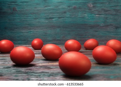 Red easter eggs over rustic background