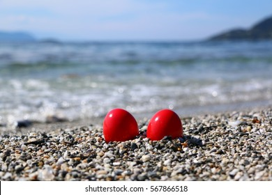 Red Easter eggs at the seashore of Milia beach, Skopelos island, Sporades