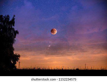 Red eclipse of the moon in the starry sky