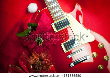 Red electric guitar with christmas ornaments. Concept image for christmas /  holiday season music event - Red Electric Guitar Christmas Ornaments Concept Stock Photo (Edit