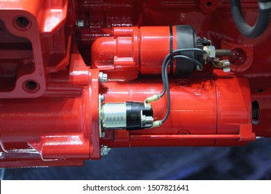 Red electric stater unit on new truck motor engine close up