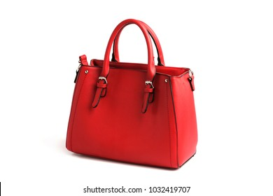 Red elegant female bag with two handles on white background isolated