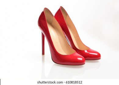 Red elegant shoes on a white background