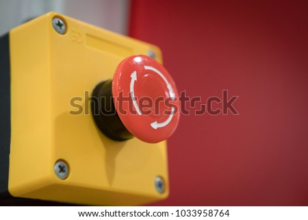 Red Emergency Button in the Factory, Safety Push in Industrial manufacturing to Stop and Cancel Production Line