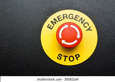 Red emergency button on black panel