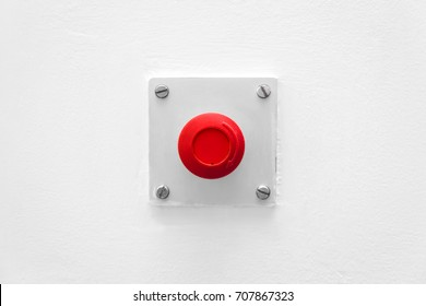 red emergency button on a white wall