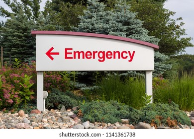 Red emergency sign and arrow pointing left on sign with white background.