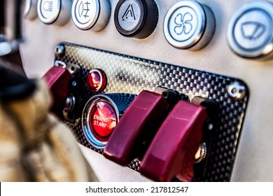 The red 'engine start' button on a nitrous oxide equipped sports car in the UK.
