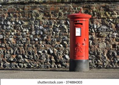 Red English pillar box or post box.