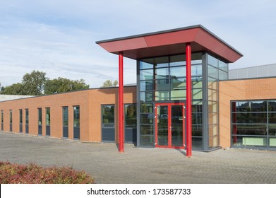 modern office building. Red Entrance Of A Modern Office Building