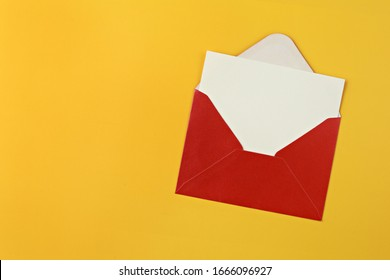 Red envelope with blank card on yellow background.