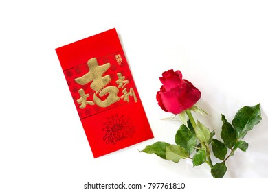 Red envelope or gratuity in new year chinese called Angpao with red rose on white background and Chinese Language on red envelope translate Good luck and to be riched