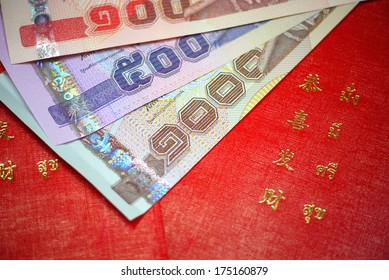Red envelope with Thai baht money - Shutterstock ID 175160879