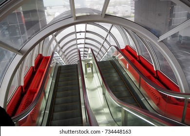 Red escalator in subway - Japan Travel