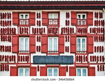 Red Espelette peppers drying in the wall of a traditional Basque house in Espelette village, Basque province of Labourd, France, Atlantic Pyrenees, Aquitaine