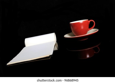 The red espresso cup and the notepad
