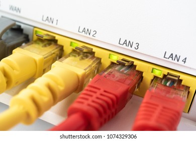 Red ethernet cables are connected to blue internet switch.