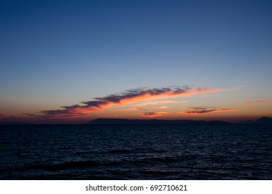 The red evening sky over the dark blue Croatian seashore