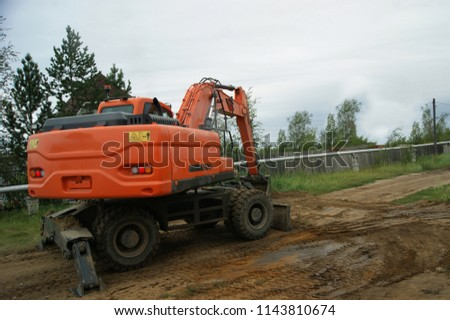 Red Excavator Begins Dig Trench Ground Stock Photo (Edit Now